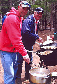 Men Grilling at Picnic